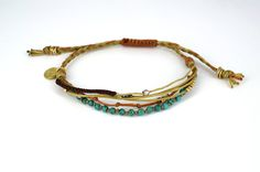 Multistrand Boho bracelet. Handmade jewel with gold plated silver, howlite gemstones and haematite star with waxed polyester cords