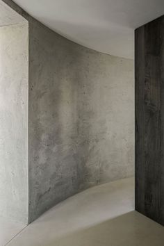 Belgian architect Arjaan De Feyter designed this minimalistic concrete apartment in one of the by Axel Vervoordt coverted old silos at the Kanaal in Wijnegem, Belgium. An industrial dream space with e