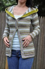 A casual hoodie worked in reverse stockinette stripes to show off the wonderful color variations in hand dyed yarn. Sport weight yarn makes this light enough to throw on as a jacket on breezy spring and summer nights at the beach or a perfect layering piece for the fall and winter.