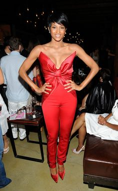 Ciara Jumpsuit - Talk about bold! Ciara steps out in a red hot satin jumpsuit for the TXT L8TR Campaign.
