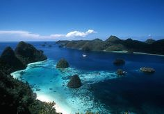 "Raja Ampat, Indonesia, West Papua province    As stunningly beautiful above water as it is below, Raja Ampat (which literally translates as ""The Four Kings"") has a startling diversity of habitats."