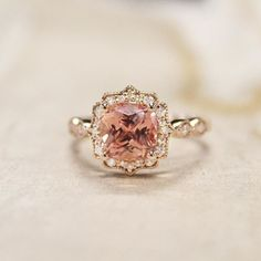 Cadenza Halo Diamond Ring custom set with a peach cushion sapphire
