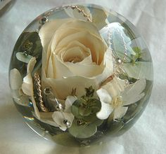 Real flowers inside a paperweight.