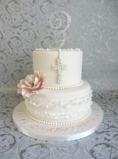 What a beautiful personalized First Communion cake - I love the cross, ruffles, pink flower and sparkly personalized initial on top! Communion Solennelle, First Holy Communion Cake, Comunion Cakes, Confirmation Cakes, Christening Cakes, Religious Cakes, Baptism Party, Baptism Ideas, Girl Christening