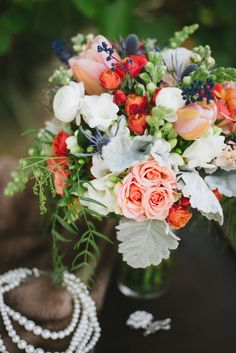 Divine Blooms and Designs Bouquet in Peach, Coral and Blue   Summer Shea Photography   See More! http://heyweddinglady.com/golden-girls-brid...