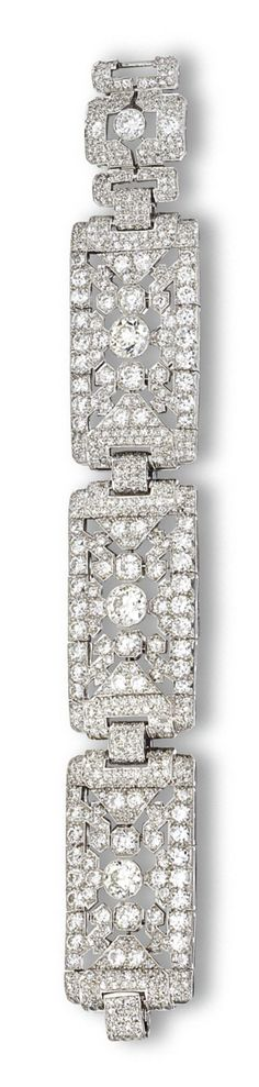 DIAMOND BRACELET, CIRCA 1930  Designed as three articulated openwork segments of rectangular shape and geometric design, set with 3 old European-cut diamonds weighing a total of approximately 4.80 carats, completed by numerous small round and single-cut diamonds weighing approximately 18.00 carats, mounted in platinum