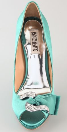 Badgley Mischka Satin Pumps. For a pop of color under that Marchesa dress. (Something ALMOST blue?)