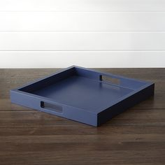 Wood serving tray in cool blue squares away drinks and snacks. Each tray is crafted with cabinetry precision, with cutout handholds for utility with style.