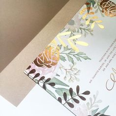 It's texture on texture on texture for this July #wedding #invitation! #Copper #foil contrasts beautifully with light and airy #florals, all packaged up in a #shimmer nude #envelopeliner! We're in #love!! #stationery #toronto #weddingseason #paperandposte #paper #design #rustic #texture #shine #copperfoil