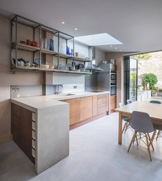 Interior shot of London house extension featuring a combination of exposed concrete and reclaimed iroko wood.