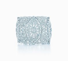 Tiffany designers drew inspiration from lace-adorned dresses for this intricate bracelet of round and oval diamond