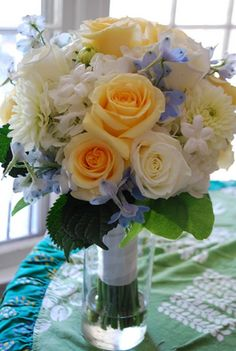 blue and yellow wedding flower bouquet, blue and yellow bridal bouquet, wedding flowers, add pic source on comment and we will update it. www.myfloweraffair.com can create this beautiful wedding flower look.