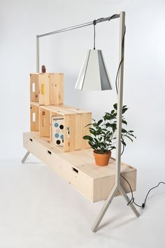 Winner of Second Place at show2012  Lydia Cambron  Contributing design Von Tundra  Photos by Darryl James  99 is a multi-use dresser designed to support daily dressing and clothing storage needs. By combining three basic storage conditions,...