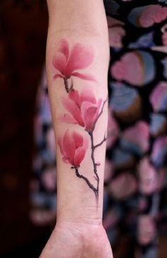 3 Pink Magnolia Flower Branch. A number of Magnolia flowers are joined to enhance the beauty of this tattoo.