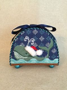 Just did the finishing of this shop model for July class at Needlepoint.com