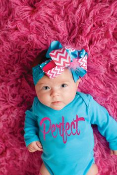 """She's your baby girl...you know she is going to be PERFECT! You will love this trendy and unique baby girl's bodysuit! Aqua bodysuit is high quality 100% cotton. Front of bodysuit reads """"Perfect"""" in sparkly glitter letters. Makes a great baby shower gift or new baby gift!    Listing includes bodysuit only!    Hair bow found here...  https://www.etsy.com/listing/206806745/extra-large-6-hairbow-boutique-hair?ref=shop_home_active_10    Leg warmers can be found here…"""