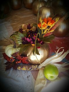 Creating a Fall centerpiece for a 60th anniversary. Will be places on white table cloth with a bed of live greens. ♡