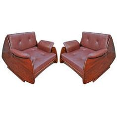 Pair of Lounge Chairs by Jorge Zalszupin | From a unique collection of antique and modern lounge chairs at https://www.1stdibs.com/furniture/seating/lounge-chairs/