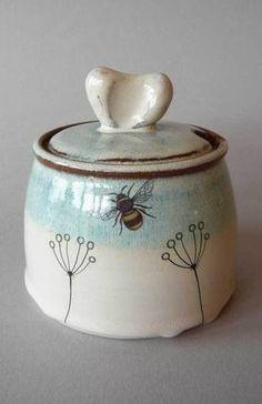 an artisan crafted honey pot