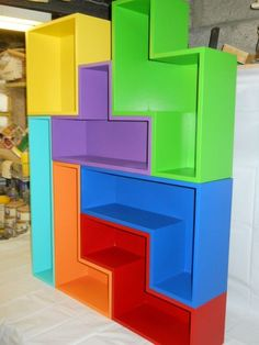 Tetris shelves by Hicks Custom Furniture. Love the bright colours! Good idea. You could have a small or large bookshelf with colours you like.