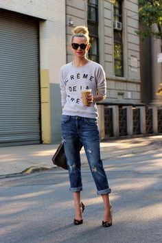Boyfriend jeans and a witty sweater. Perfect for fall weather. Creme de la creme.