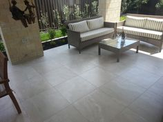Covered patio tiled with Travertino - Porcelain tiles with the look of popular classic Travertine stone Heritage Tiles | New Arrival: Travertino Tile Collection