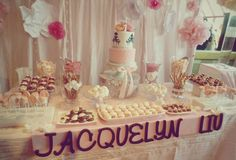 Dessert table! Cake, macarons, chocolates, pretzels, and more sweets! #florals #white #pink #girly #romantic @cindyatol