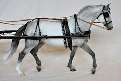Model horse with a gorgeous custom made harness.