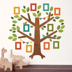 NEW - Family Tree. Display your family photos with our family tree FABRIC wall decal. Comes with decal photo frames to display your best photographs! Available from Petit Collage