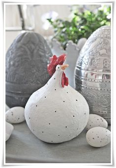 Love the chicken, but the eggs behind her could be paper mache too - of balloons