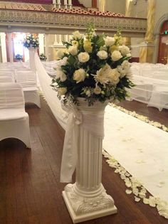 flower arrangement on pillar column for wedding ceremony at adelaide town hall wwwhouseofthebride