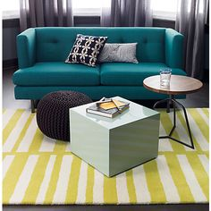 instead of just 1 big coffee table - more mobile options - cb2