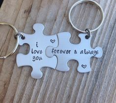 I love you forever & always- hand stamped on two stainless steel puzzle pieces , perfect for a birthday or anniversary Comes in a brushed finish , this listing is for 2 keychains they measure 1 1/2 x 1 inches . Created by CMKreations 2013 original design Thanks ! please note that these