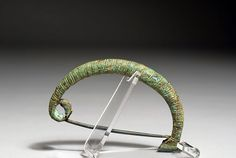 This is an image of a fibula discussed earlier. The fibula is like a decorative safety pin that was used by Ancient Greeks to hold together their himation which was draped around the body. The dress had very little sewing or cutting. The fibula was used to pin the cloth in various areas.