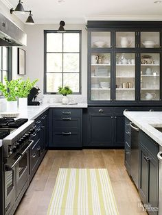 Bin-style handles add to the traditional character of this dark gray kitchen.
