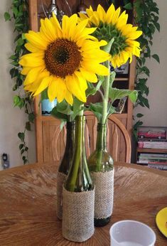 9 Ways to Create Stunning Fall Wedding Centerpieces---rustic bottle centerpieces with sunflowers and burlap, diy table settings easy to make for a country wedding Baby Bottle Decorations, Sunflower Wedding Decorations, Sunflower Centerpieces, Sunflower Party, Sunflower Baby Showers, Bottle Centerpieces, Rustic Wedding Centerpieces, Bridal Shower Decorations, Wedding Flowers