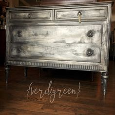 this sweet petite dresser will add a chic glam elegance to your boudoir!  hand painted in a lovely layered matte black, soft warm silver, glazing, & gilding with specks meant to mimic old mercury glass  {one of a kind paint finish on a depression era dresser}  measures 46 wide x 20 deep x 35 high  wear consistent with age (its almost 100 years young) but still solid and drawers slide as expected...nothing broken but the distinct glide of wood on wood. :) available in our montclair NJ sho...