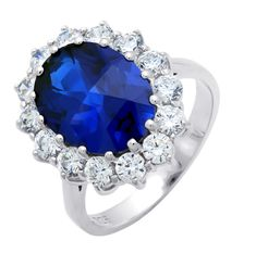 """CRISLU Oval Sapphire Ring - Sizes: 5, 6, 7, 8, 9 - Carat total weight: 6.90, center stone is 5.50 carats - .925 sterling silver finished in pure platinum - Clear and sapphire CZ - Stone is 0.7"""" long -Lifetime Warranty -100% Hypo-Allergenic -Non-Conflict - CTTW: 2.85 - Platinum Finish - Authorized CRISLU Retailer - Note: please inquire for ship time availability - FREE SHIPPING on orders over $100 ! Pure Platinum, Cubic Zirconia Rings, Jewelry Design, Designer Jewelry, Heart Ring, Sapphire, Bling, Engagement Rings, Stone"""