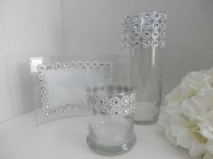 Wedding centerpiece includes picture frame for table number, rhinestones flower holder, candle holder . This is a beautiful table setting for your
