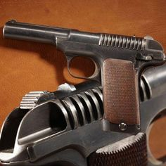 SAVAGE MODEL 1907 .45 PISTOL.: This eight-shot pistol was utilized by Savage as the prototype for the redesigned handgun that would be supplied for the 1910 trials. The hand-checkered grip panels, here held in place by screws on this model, were later altered to slide onto the frame and be retained without screws.