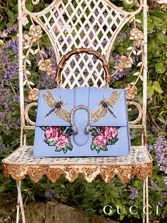 Embroidered dragonfly and roses appliqués decorate the Gucci Dionysus bag by Alessandro Michele by Gucci Cruise 2017.