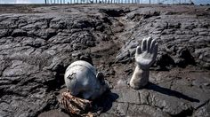 Statues stand semi-submerged in mud, a symbol of the human toll of the 2006 disaster, at a mud volcano area in Sidoarjo, East Java that erupted and swallowed entire villages. (Adek Berry/AFP/Getty Images)  weather.com