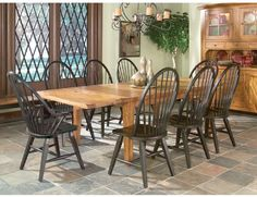 "Rustic Traditions Dining Sets.  44x72 table expands up to a crowd-worthy 108"" wide!  Antique black and rustic oak.  Available at Just Cabinets Furniture & More and online at JustCabinets.com"