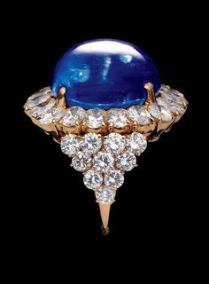 Diamond and gold ring with untreated Kashmir sapphire.