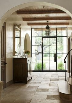 Steel door, bleached wood ceiling, limestone floor, plaster walls, arched doorways -- love the floors spilling through the foyer past the stairs Halls, Limestone Flooring, Limestone House, Travertine Pavers, Bleached Wood, Entry Hallway, Entrance Hall, Wood Ceilings, Ceiling Windows