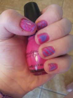 I did this myself with the help of Sally Hansen purple nail art pen, and Sinful Colors Professional nail polish called Oasis. Fron the thumb to pinkie is cheveron, polka dots, a heart, diagonal lines, and a bow!