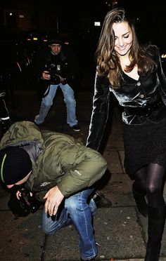 """Only Kate would help a paparazzi guy.  """"No, please. Kneeling is not necessary - yet!"""""""