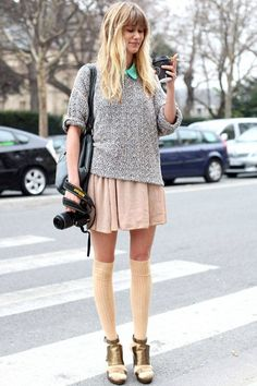 A local photographer wears an American Apparel sweater, shirt, skirt, and socks, and Michel Perry shoes.    - ELLE.com