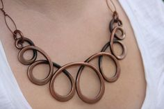 copper necklace by Adrian Prazen on etsy: this is lovely wire work, not easy to do and so smooth!!