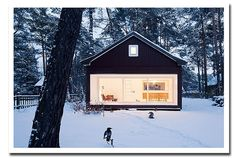 """A winter cabin designed by Atelier St, a German architecture company.  translate.google.com worked well on the Atelier St website (http://atelier-st.de/projekte/bauten/waldhaus.html): """"In the middle of a tall, dominated-by-pine-trees forestland, is a new wooden house."""""""